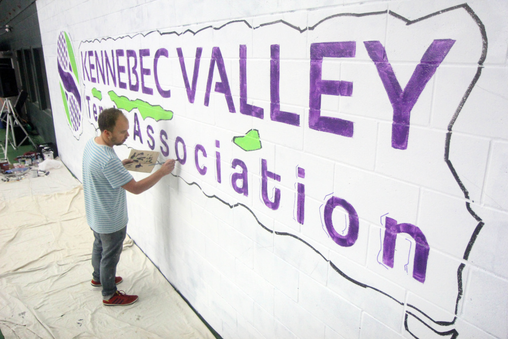 """Gardiner artist Matt Demers paints a mural during an """"Art on the Courts"""" fundraiser in Augusta on Sunday to benefit Maine General's OutPatient Plus Program and the Kennebec Valley Tennis Association."""