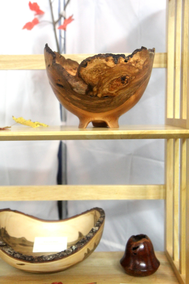 """Some wooden bowls on display made by Dennis Curtis at an """"Art on the Courts"""" fundraiser in Augusta on Sunday to benefit Maine General's OutPatient Plus Program and the Kennebec Valley Tennis Association."""