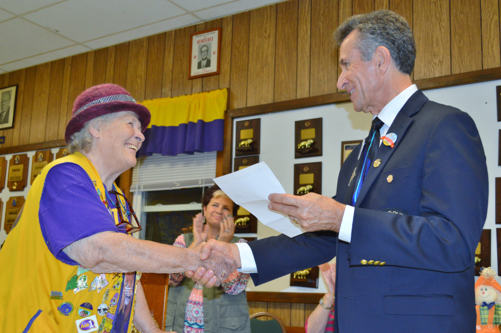 Mary Follett, left, accepts 30 year service award from District Governor Norman Hart as Whitefield Lions Club President Cindy Haskell Lincoln looks on.