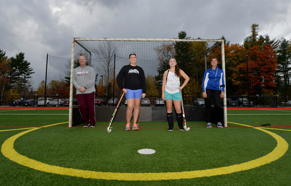 The Hughes family from left to right Greg, Meghan, Alison, and Nancy pose  at Thomas College after an Oct. 29, 2015 practice.
