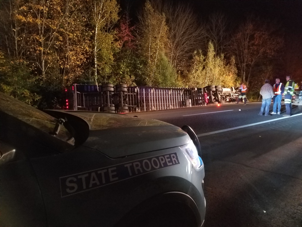 A tractor trailer carrying a load of french fries rests on its side after crashing on I-95 Monday night. The driver was reportedly blinded by the setting sun and drove into the median ditch.