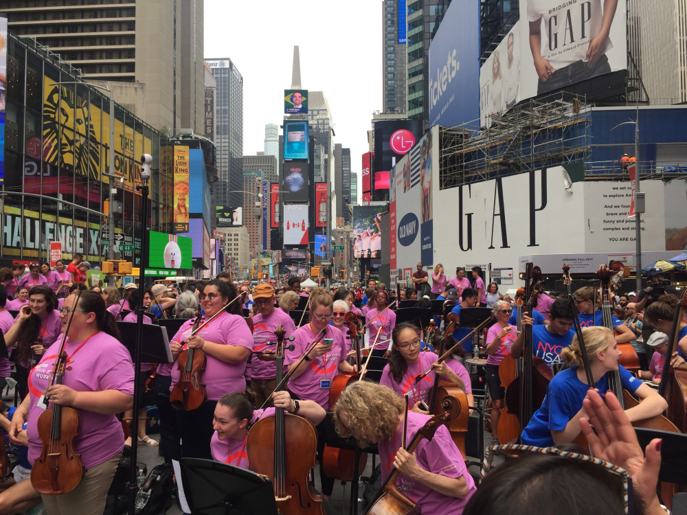 """Phoebe Payne, a K-12 music teacher at Forest Hills School in Jackman, attended the annual Summer Music Teacher Educator's Workshop in July. The educators were asked to take part in a """"pop-up"""" performance in New York City's Times Square."""