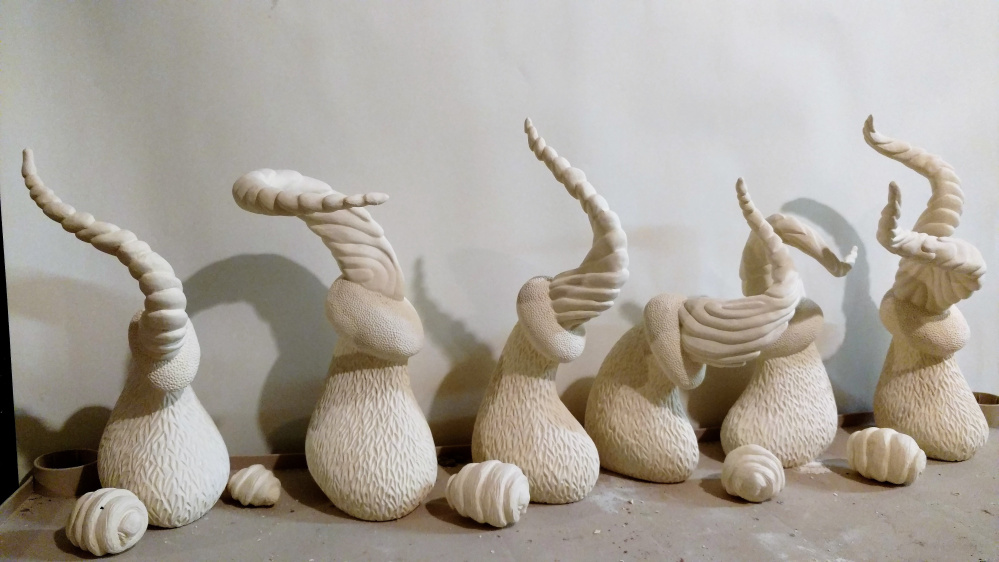 """""""Bovine Hierarchy,"""" ceramic sculptures by Dylan Gifford."""