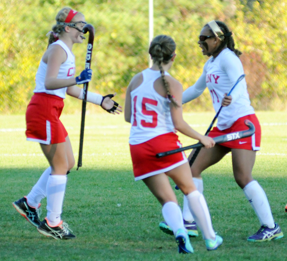 Cony's Julia Reny, left, and Faith Leathers-Pouliot rush in to hug teammate Kami Lambert after she scored an overtime goal to beat Mt. Ararat in a Class A North quarterfinal game Tuesday in Augusta.