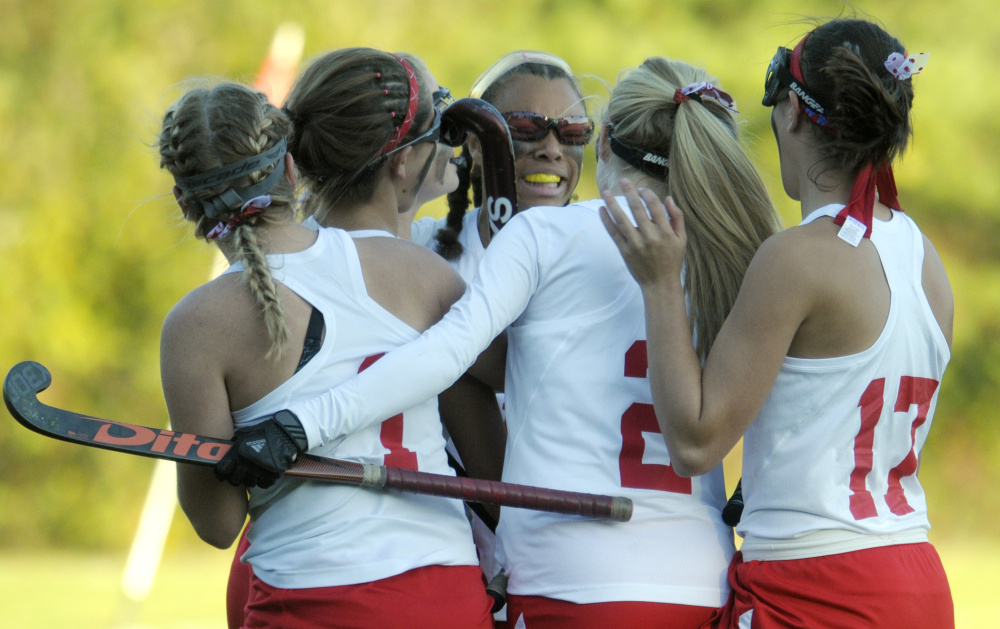 Teammates surround Cony's Kami Lambert, center, after she scored an overtime goal to beat Mt. Ararat in a Class A North quarterfinal game Tuesday in Augusta.