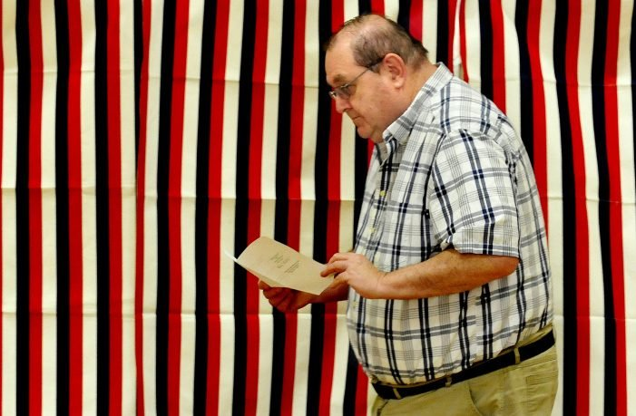 School Administrative District 13 board Chairman Brian Mallow looks over his ballot July 25 before casting it at Quimby School in Bingham. Residents of Bingham and Moscow passed the school budget by six votes in the Tuesday referendum, the fourth time the budget had gone to a referendum.
