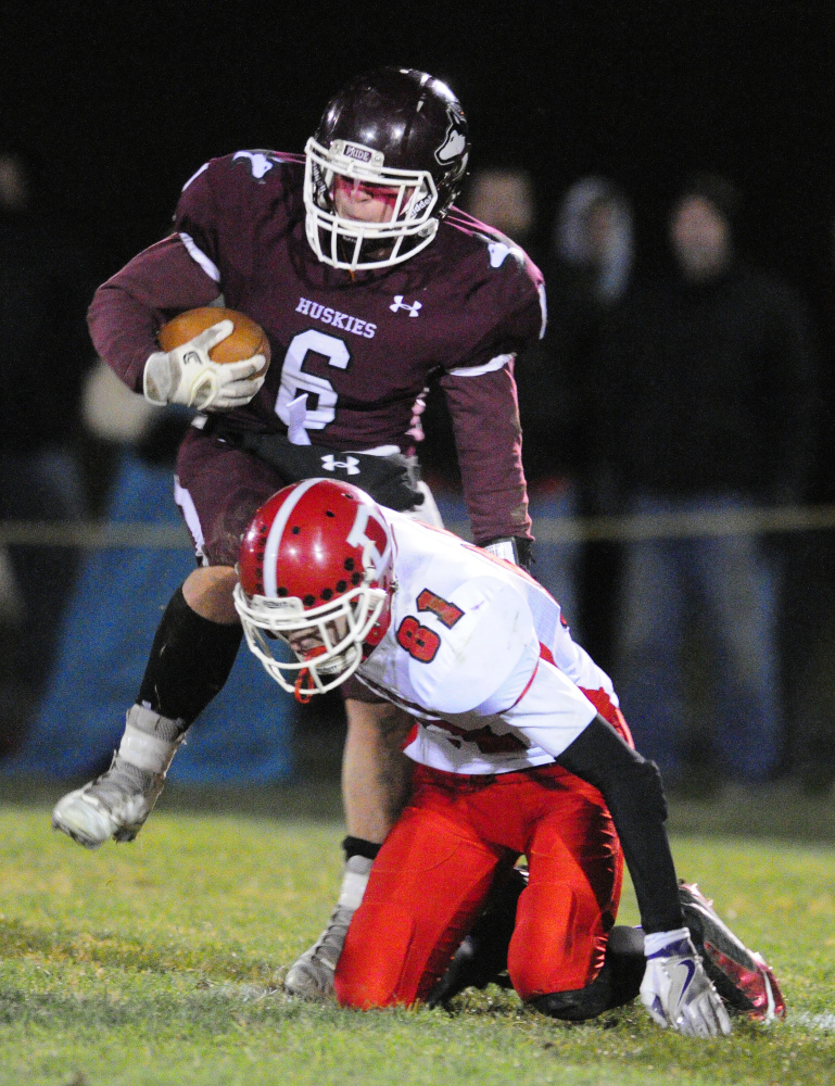 MCI running back Adam Bertrand, top, evades Dexter defender Jason Campbell en route to scoring touchdown during the Little Ten Conference championship game last year at Alumni Field in Pittsfield.