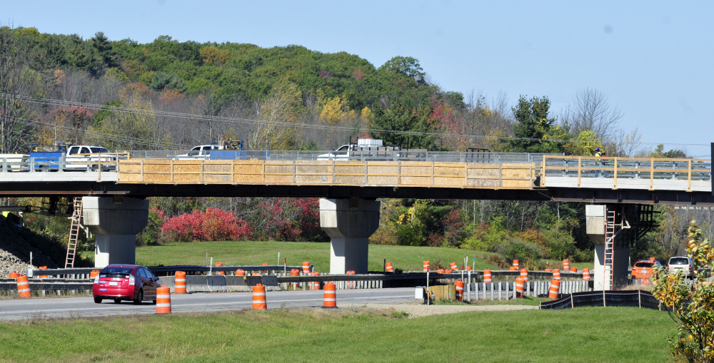 Workers complete the bridge replacement work Friday before re-opening the Winthrop Street bridge over Interstate 95 in Hallowell.