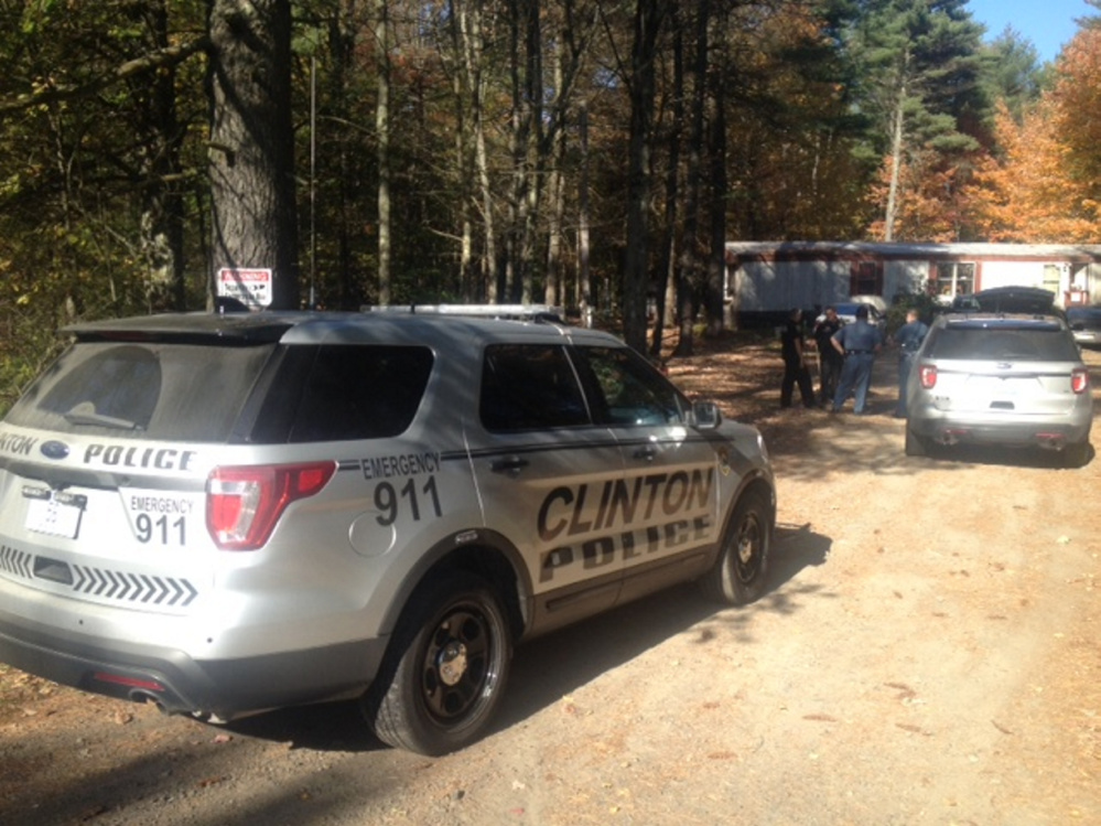 Maine State Police, with a tracking dog, and Clinton police confer Saturday afternoon at the scene on Hinckley Road in Clinton where a stabbing was reported. A male juvenile was arrested later nearby in connection with the incident.