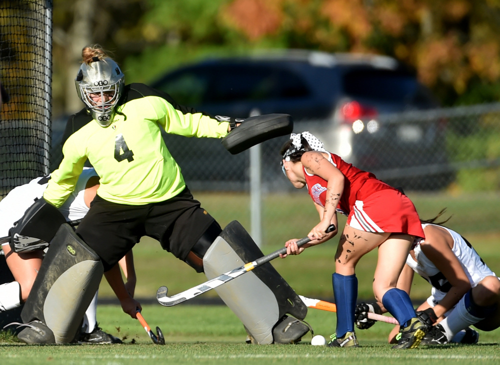 Skowhegan goalie Leah Savage makes a save on a shot from Messalonskee forward Chloe Tilley, right, during a Class A North game earlier this season in Skowhegan.