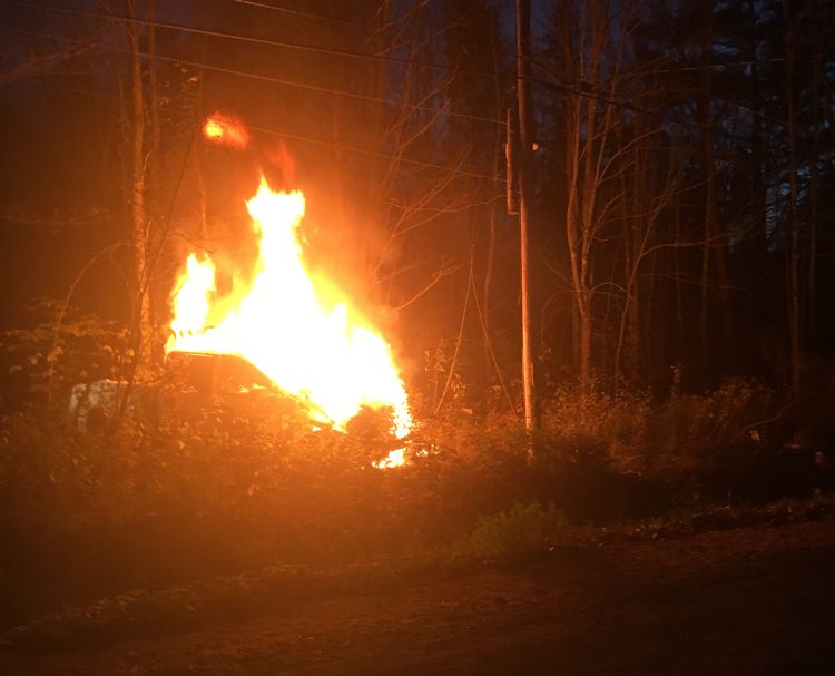 A pickup truck took out a utility pole and burst into flames Sunday evening on the Red Bridge Road. The driver fled on foot but turned himself in Monday to the Skowhegan police.