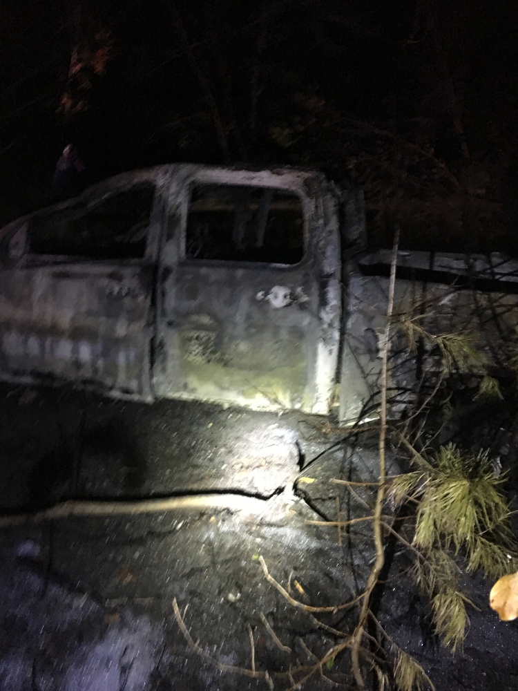 A pickup truck that crashed into a utility pole was destroyed by an ensuing fire on the Red Bridge Road Sunday evening. The driver fled on foot but turned himself in Monday to the Skowhegan police.