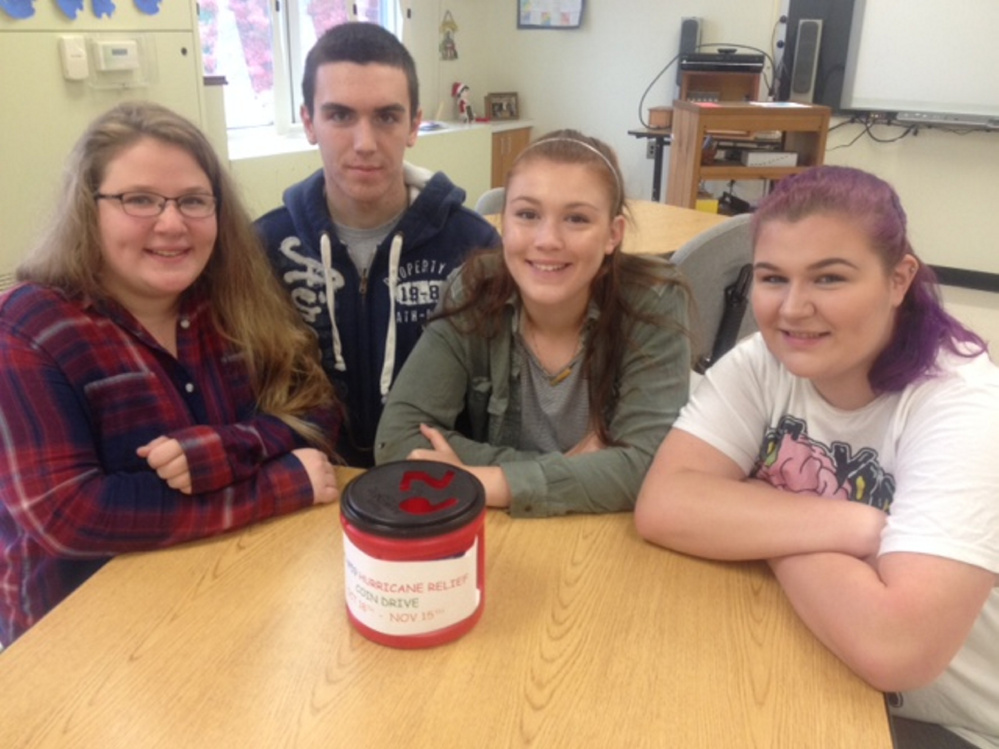 Madison Area Memorial High School Community Service class members, from left, Madeleine Theriault, Tyler Briggs, Lauren Hay and Sabrina Furbush.