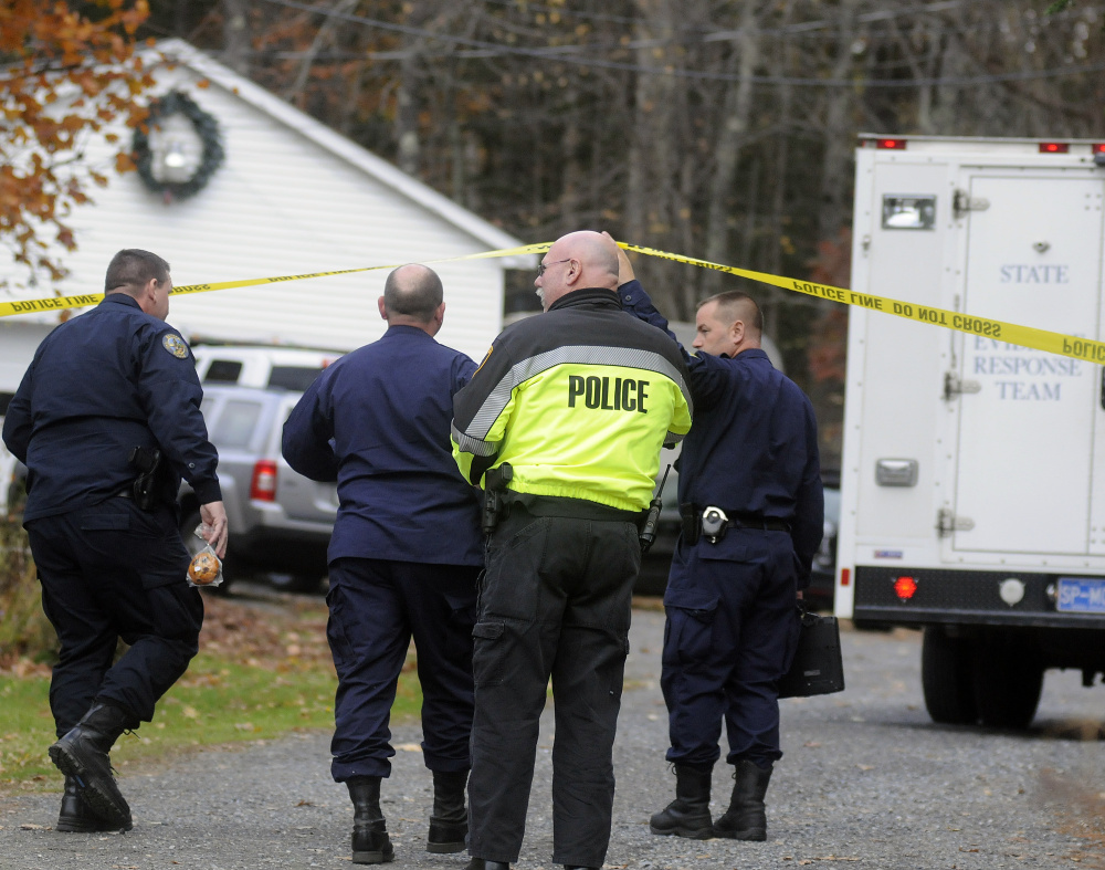 State Police Detectives enter the driveway of a home in Winthrop on Oct. 31, 2016, where the bodies of Antonio and Alice Balcer were discovered early in the morning.
