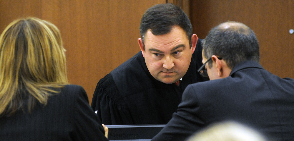 Superior Court Justice Eric Walker confers Nov. 29, 2016, with Kennebec County Assistant District Attorney Tracy DeVoll and defense attorney Charles T. Ferris during the Augusta civil trial of Danielle Jones, co-owner of the two dogs involved in an attack that killed another dog.