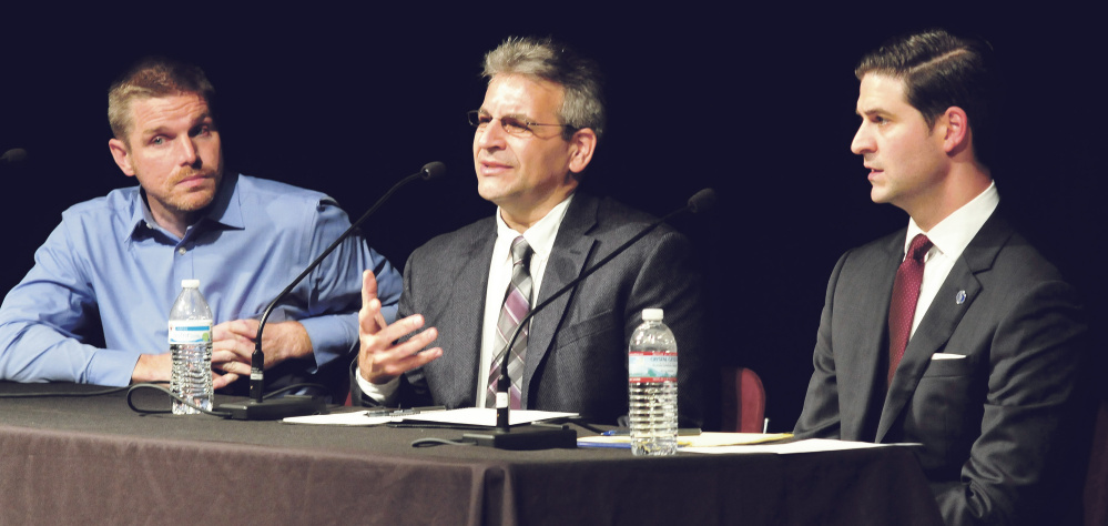Candidates for Waterville mayor take part in a debate Tuesday night at Thomas College in Waterville. From left are Erik Thomas, John Levesque and Nick Isgro.