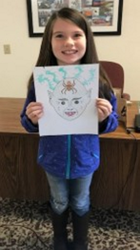 Camryn Swails, of Sidney, won the Harvest Festival coloring contest for children 6 to 8 years old.