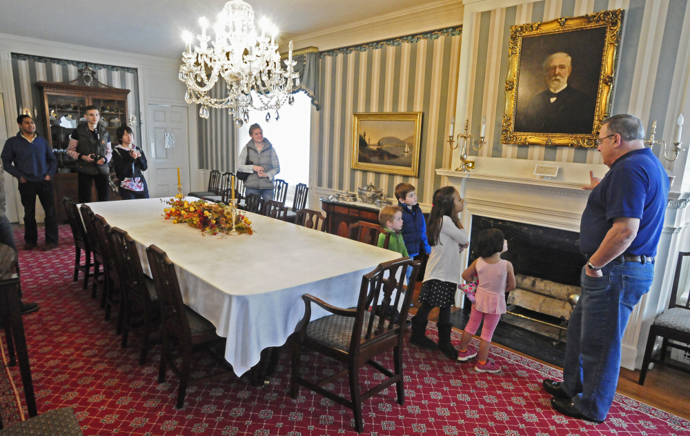Gov. Paul LePage points out a picture of James G. Blaine while leading a tour of the governor's mansion during the Blaine House Food Drive on Nov. 7, 2015 at the Blaine House in Augusta.