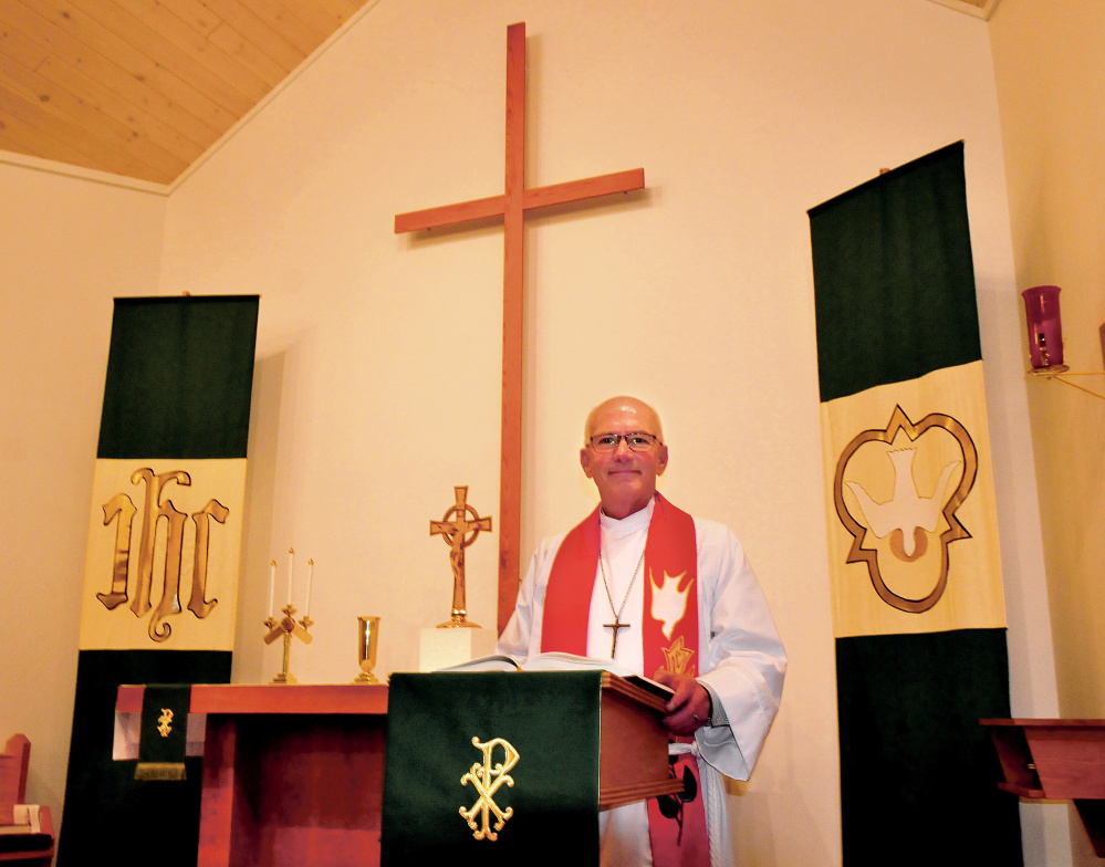 Pastor Paul Nielsen stands in the Lutheran Church of the Resurrection on Thursday in Waterville. The church will hold a special worship service and other activities Sunday to mark the 500th anniversary of the start of the Protestant Reformation.