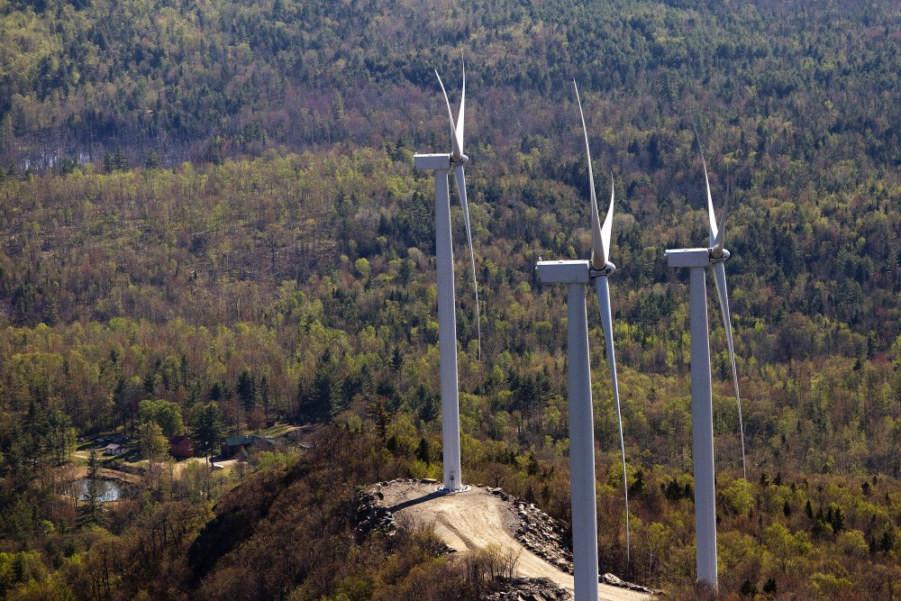 Three wind turbines owned by Patriot Renewables are seen on May 14, 2015, along Saddleback Ridge in Western Maine.