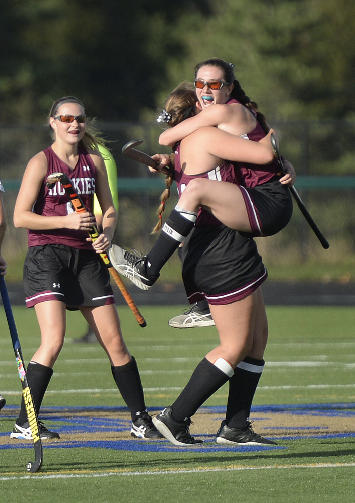 Maine Sunday Telegram photo by Shawn Patrick Ouellette   Addi Williams jumps into the arms of Maine Central Institute teammate Eva Bickford after Williams scored a second half goal in the Class B state championship game Saturday against York at Falmouth High School.