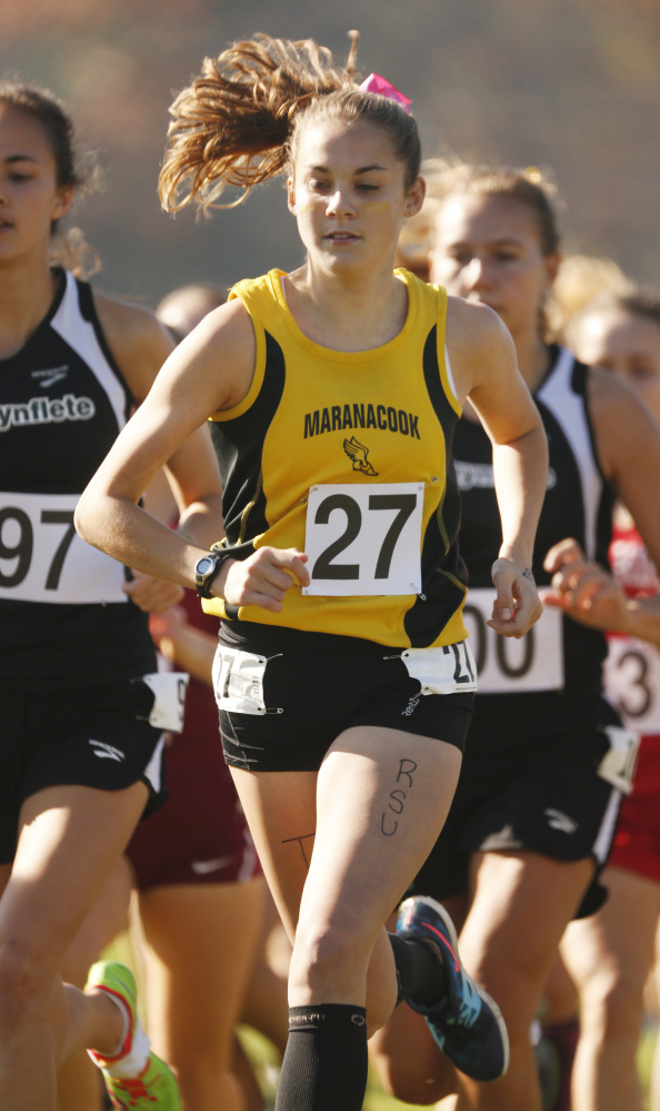 Maranacook's Molly McGrail (27) runs in the pack at the start of the Class C cross country state championship meet Saturday at Twin Brooks Recreation Area in Cumberland.