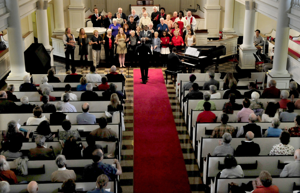 A choir sings during an Ecumenical Gospel Celebration of the 500th anniversary of the Reformation in the packed Lorimer Chapel at Colby College in Waterville on Sunday.