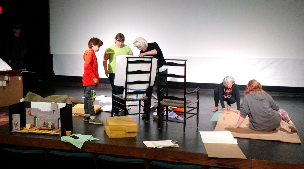 During a Creative After-School Arts workshop participants, from left, Orion LaVallee, Anna Rose Ross, Janice Adler, Shirley Schrader and Lily Lavallee create a shared vision. They worked on the set for