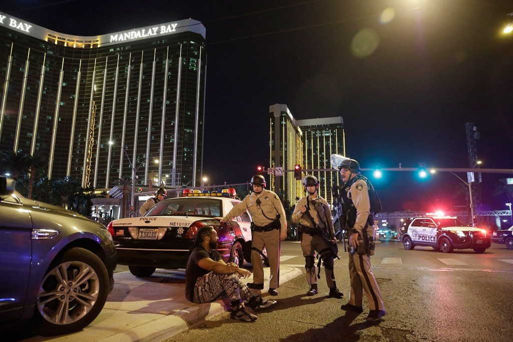 Police officers stand at the scene of a shooting near the Mandalay Bay resort and casino on the Las Vegas Strip.