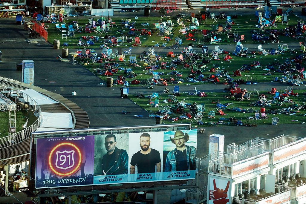 Debris litters a festival grounds across the street from the Mandalay Bay resort and casino Tuesday in Las Vegas. Authorities said Stephen Craig Paddock broke windows on the casino and began firing with a cache of weapons, killing dozens and injuring hundreds at a music festival at the grounds.