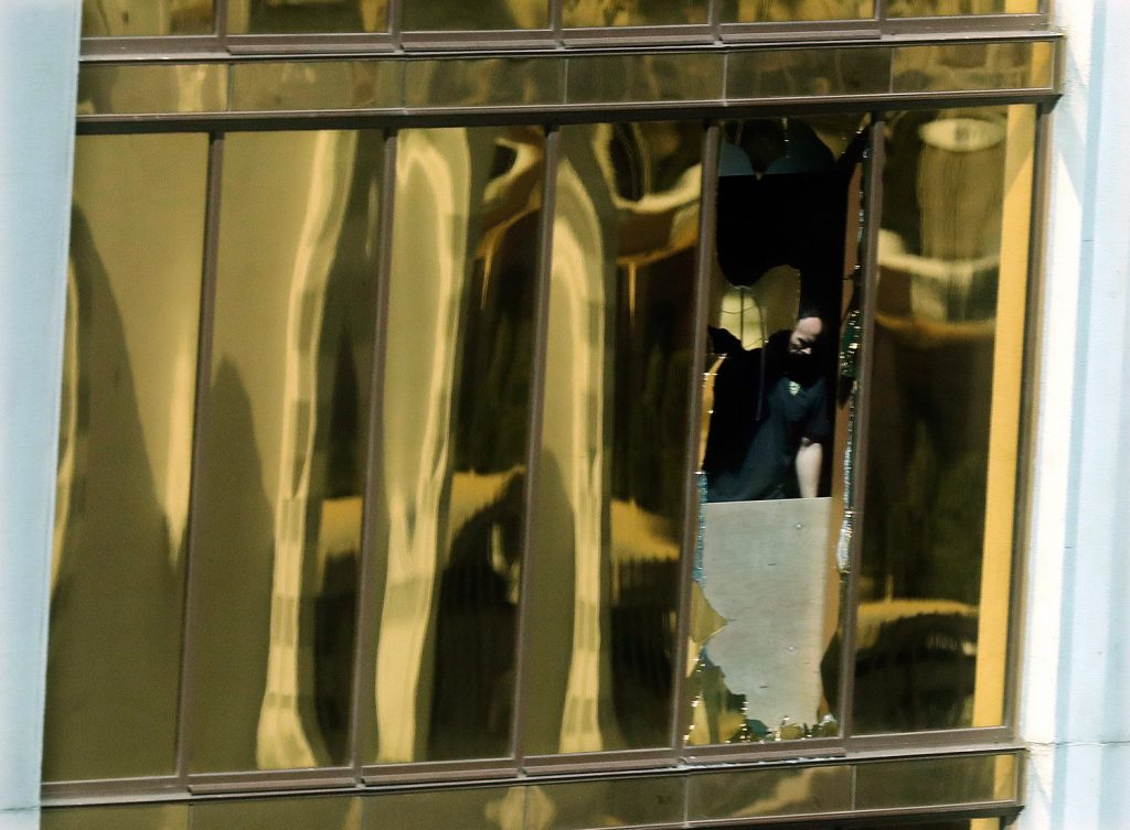 An investigator works Tuesday in the room at the Mandalay Bay Resort and Casino where a gunman opened fire on a music festival Sunday night. The sheriff said Stephen Paddock