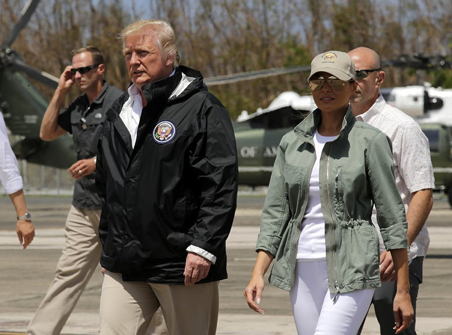President Trump and first lady Melania Trump arrive at the Luis Muñiz Air National Guard Base in San Juan, Puerto Rico.