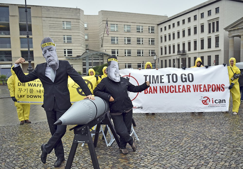 Activists of the International Campaign to Abolish Nuclear Weapons – ICAN – protest the ongoing nuclear standoff between North Korea and the United States in front of the U.S. Embassy in Berlin on Sept. 13, 2017.