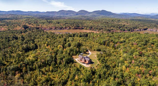 A view of the Brownfield property the Donlon family is bringing to an upscale auction next month. They spent 26 months hand-building the 6,000-square-foot red cedar log cabin at the center of 173 acres.