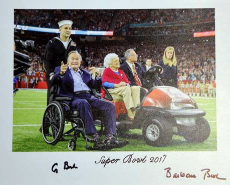 President George H.W. Bush has donated the socks he wore for Super Bowl 51 to the Roman Catholic Diocese of Portland's Harvest Ball.