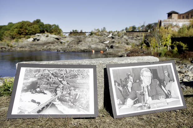 Pictures of U.S. Sen. Edmund Muskie of Maine and of pollution piled up below the Great Falls in Lewiston and Auburn sit near the riverbank during a news conference Tuesday.