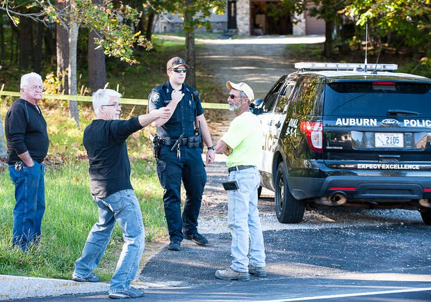 Michael Koch, center, explains to Auburn Police Officer Thomas Ellis that he met a burglary victim at her home on Park Avenue in Auburn on Thursday afternoon after she freed herself.
