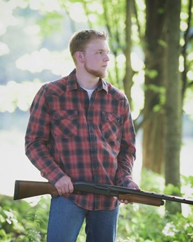 Wade Gelinas hoped the Bonny Eagle High School yearbook would use a photo in which he was holding his shotgun. Gelinas says his sport is hunting.