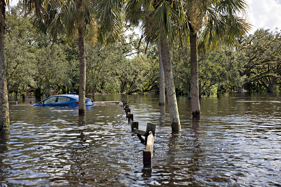 A car sits submerged in floodwaters along a road in Buckingham, Florida, on Sept. 12, 2017.