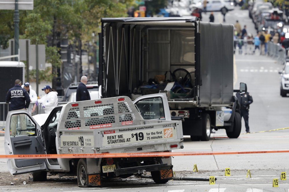 A damaged Home Depot truck remains on the scene Wednesday after the driver mowed down people on a riverfront bike path near the World Trade Center memorial on Tuesday in New York.