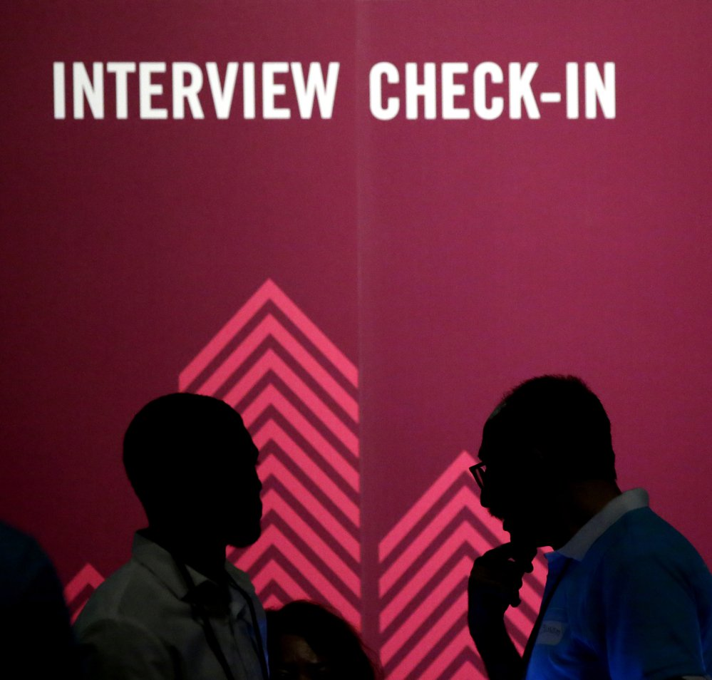 Job seekers chat during an Opportunity Fair and Forum employment event in Dallas. A poll found that half of U.S. job applicants have been asked inappropriate questions.