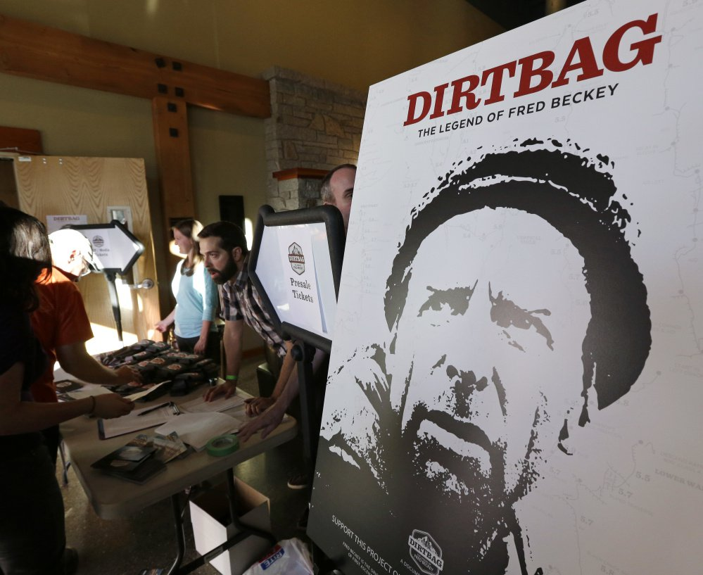"A poster for ""Dirtbag: The Legend of Fred Beckey,"" a documentary feature film about his life, is displayed at a promotional event for the film in Seattle. Beckey, 94, was a legendary mountain climber who achieved more first ascents than any other mountaineer and wrote the definitive guidebooks to a major North American mountain range."