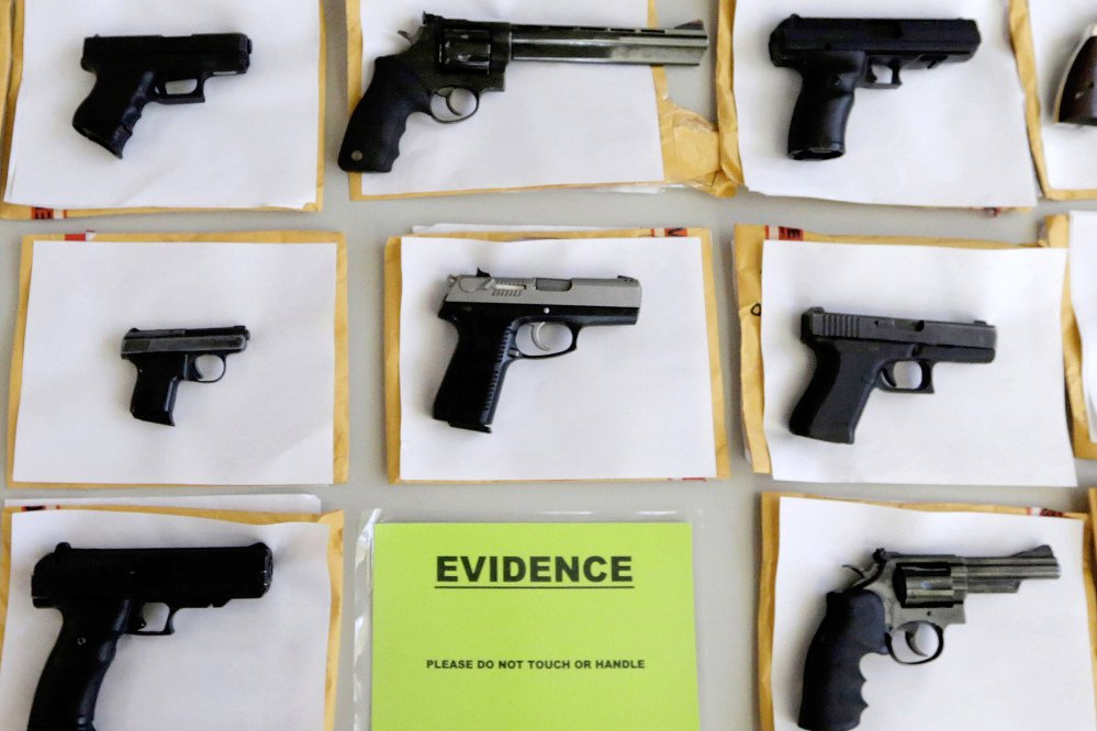In this July 7, 2014 file photo, Chicago police display some of the thousands of illegal firearms confiscated during the year. In a government report released on Friday, Nov. 3, 2017, the U.S. rate for gun deaths has increased for the second straight year, following 15 years of no real change.