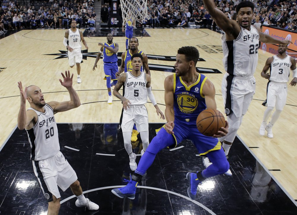 Golden State Warriors guard Stephen Curry (30) drives to the basket against the San Antonio Spurs during the first half of an NBA basketball game, Thursday, Nov. 2, 2017, in San Antonio. (AP Photo/Eric Gay)