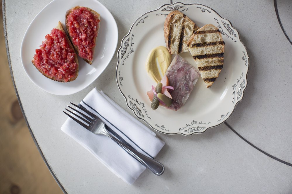 Tomato bread, Chaval's version of Spanish pan con tomate, and pork terrine, served with Dijon mustard and topped with homemade pickled local pear.