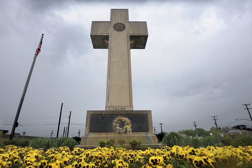 The World War I memorial cross on a Maryland highway median is pictured in Bladensburg, Md.