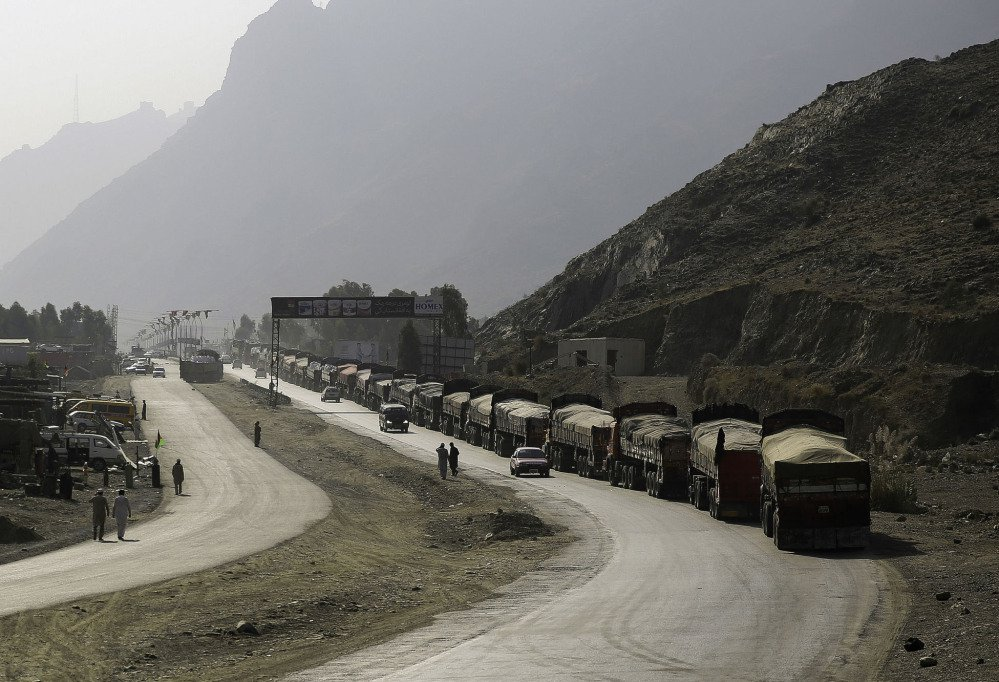 Trucks line up to enter Pakistan at the Torkhum border crossing in Afghanistan. There are 235 crossing points, some frequently used by militants and drug traffickers.