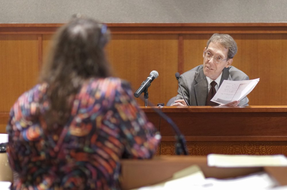 Ned Chester, one of Anthony Sanborn's attorneys during his 1992 murder trial, reviews documents with attorney Amy Fairfield during Sanborn's post-conviction review at the Cumberland County Courthouse on Monday. Sanborn spent 27 years in jail for the murder of Jessica Briggs but was released on bail in April after a key eyewitness for the state recanted testimony she gave at the 1992 trial.