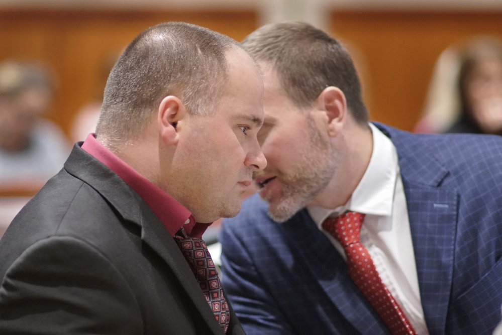 Attorney Timothy Zerillo consults Monday with Anthony H. Sanborn Jr. during testimony at his post-conviction review.