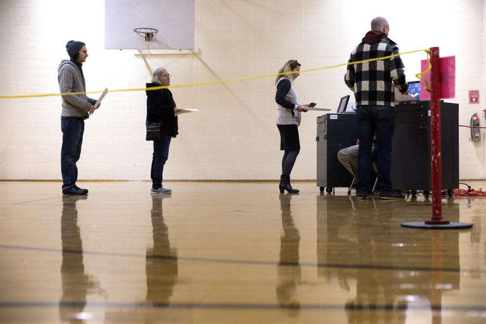 PORTLAND, ME - NOVEMBER 7: The line for the ballot machines at Reiche Elementary School dwindles after the morning rush. (Staff photo by Ben McCanna/Staff Photographer)